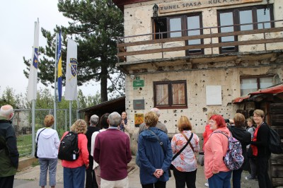 Our tour group outside the house where the tunnel was built. Notice the gun shot damage to the house!