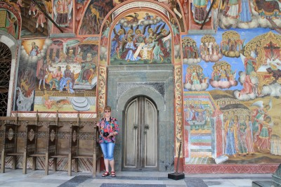 Judy posing at a door that is a side entrance to the church