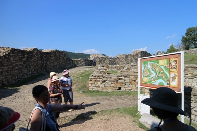 The guide is explaining the area from the map