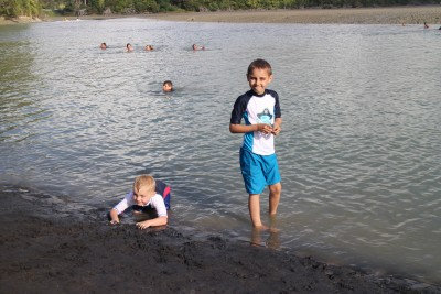 The Grandsons enjoying the Urenui river.