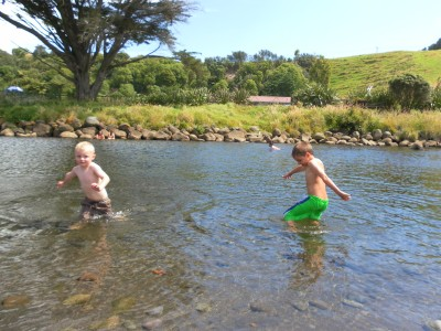The grandsons are enjoying the river on a lovely summers day.