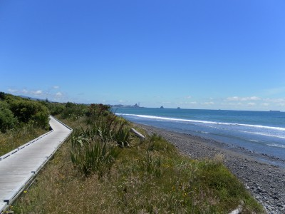 Keep riding or walking the walkway and look back and this is the view of the place we started, Port Taranaki, way in the distance. And, you can still keep walking right to Tiromoana Crescent at the end of Wills Road!