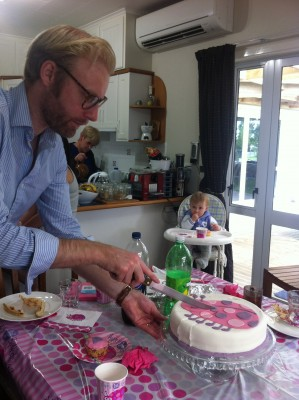 Here's Daddy Daniel cutting Sophie's cake
