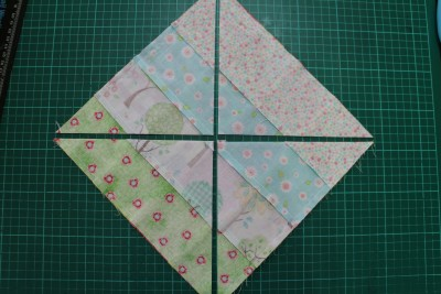 You should end up with your large square cut into four like this!