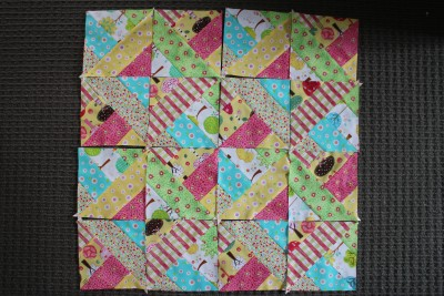 Once all four big squares have been cut up, place them together again in the way that you want to sew them up.
