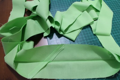 The next stage is the binding. I cut three inch strips and joined them together to make one big long strip. Fold it in half and iron the fold.
