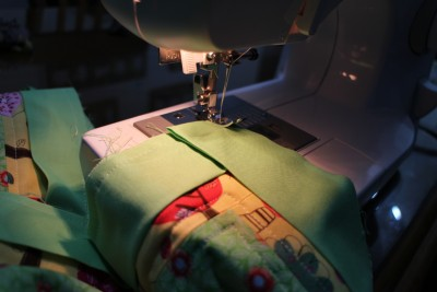 Turn the cloth around and fold the binding to have a straight edge along the top, then just recommence sewing the seam.