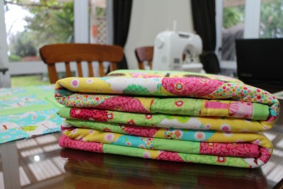 All folded up ready to be given to two very special little babies. Fable got the green edged one, and Zoe got the pink edged one.