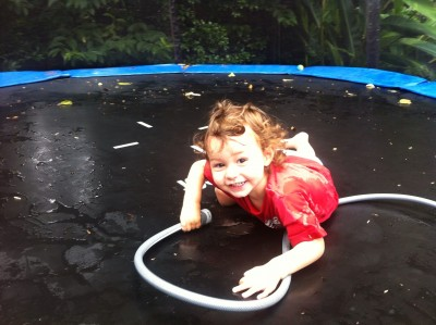 Luke loved playing with the hose on the trampoline :-)